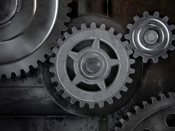 depositphotos_69788219-stock-photo-gears-on-dark-background-abstract.jpg